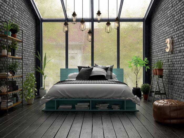 Tehla s tmavým povrchom zmení celkový ráz izby na nepoznanie. Ak ste milovníci flóry, takáto spálňa vám učaruje.